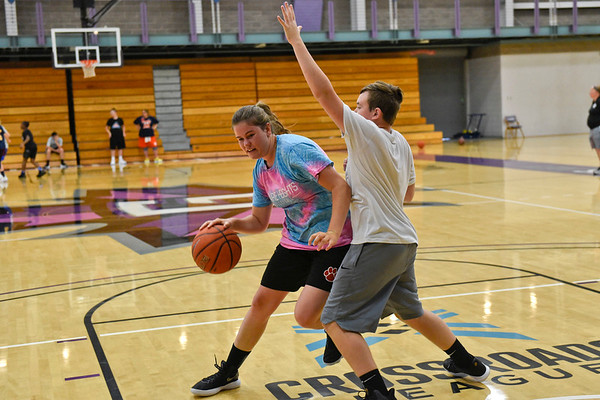 BEN MIKESELL | THE GOSHEN NEWS<br /> Kennedy Kugler, 15, of Orland, works in the post against Brady Gawthrop, 14, of Bristol, during a three-on-three tournament in the McCracken Basketball Camp Tuesday at Goshen College.
