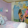 Roger Schneider | The Goshen News<br /> Shelley and Sy Clements show their daughter Cierra her bedroom Sunday morning. Local volunteers and My Happy Place teamed up to renovate the room for functionality as well as beauty this weekend.