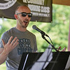 "BEN MIKESELL | THE GOSHEN NEWS<br /> Noah Bush, host of ""There is No Godcast,"" speaks to the crowd gathered for Saturday's rally at Rogers Park in Goshen."
