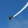 GEOFF LESAR | THE GOSHEN NEWS<br /> <br /> Ashley Shelton performs a wing-walking stunt as her husband, Greg, pilots the plane Saturday evening during America's Freedom Fest at Goshen Municipal Airport.