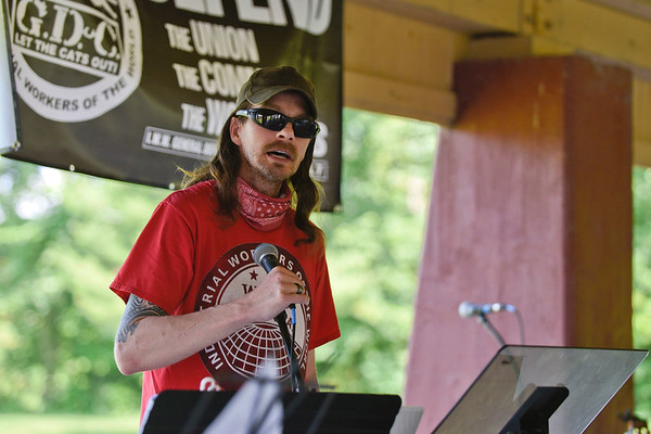 BEN MIKESELL | THE GOSHEN NEWS<br /> Tim Huser, the local branch secretary/treasurer for the Industrial Workers of the World union, speaks to the crowd gathered for Saturday's rally at Rogers Park in Goshen.