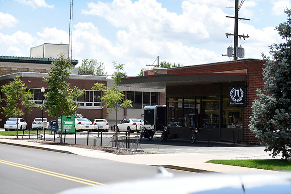 BEN MIKESELL | THE GOSHEN NEWS<br /> The Goshen Police and Courts Building, pictured in the background, will be undergoing an air quality assessment to see if the former Fiedeke dry cleaning building (now Janus Motorcycles) in the forefront has had any environmental impact on its southerly neighbor.