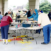 JOHN KLINE | THE GOSHEN NEWS<br /> Volunteers with the Elkhart County chapter of national aid organization Sleep in Heavenly Peace work at sanding boards that will ultimately be turned into beds during the first-ever national Bunks Across America bed build challenge held Saturday morning at the Life Center in Goshen.