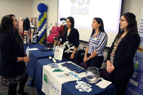AIMEE AMBROSE | THE GOSHEN NEWS <br /> (from left) Radi Buenrostro of Merino Law Firm talks with Ivannia Graber, Maria Sanchez and Cristina Diaz of Insight Accounting Group during the Indiana Latino Business Expo 2019 at the Ivy Tech Community College campus along C.R. 18 near Elkhart Wednesday. Buenrostro served as an interpreter at the event.