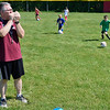 "BEN MIKESELL | THE GOSHEN NEWS<br /> Coach Mark Aukerman leads campers in a game of ""red light, green light"" at the end of soccer camp Tuesday morning at Shanklin Park."
