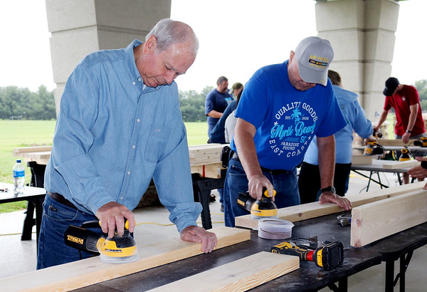 JOHN KLINE | THE GOSHEN NEWS<br /> From left, Gary Huber and Chuck Rink, both of Goshen, work on sanding boards that will ultimately be turned into beds during the first-ever national Bunks Across America bed build challenge held Saturday morning at the Life Center in Goshen.