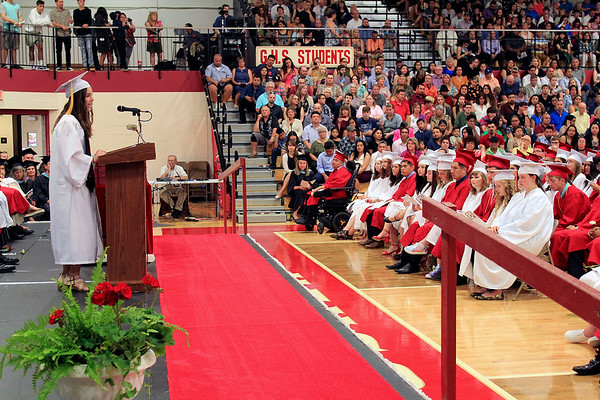 Roger Schneider | The Goshen News<br /> Julia Giddens stands before her classmates at Goshen High School Sunday to offer insights on what it means to graduate high school.