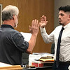 JOHN KLINE | THE GOSHEN NEWS<br /> Goshen Board of Public Works and Safety member Michael Landis, left, conducts the swearing-in ceremony for Manuel Alejandro Aldana following his hiring as a new probationary patrol officer with the Goshen Police Department during Monday's board meeting.