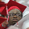Roger Schneider | The Goshen News<br /> Kevon Coleman tucked his tassle behind his eyeglasses to keep it from swinging around as he watches the crowd Sunday at the Goshen High School graduation ceremony.