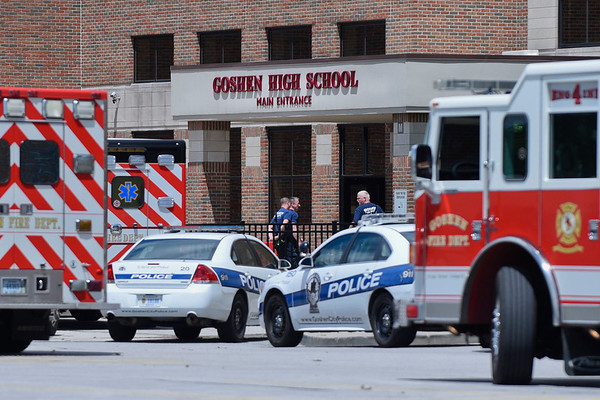 BEN MIKESELL | THE GOSHEN NEWS<br /> Goshen firefighters walk into Goshen High School following a training session Monday afternoon.