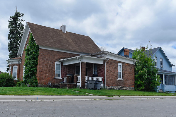 BEN MIKESELL | THE GOSHEN NEWS<br /> This brick home, located at 401 S. Third St., and a connected property at 204 W. Madison St., are both currently being considered for demolition by the Goshen Redevelopment Commission, a plan which has some city residents concerned given the potential historical significance of the structures.