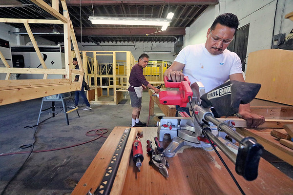 ROGER SCHNEIDER | THE GOSHEN NEWS<br /> Entrepreneur Jose Francisco Leal cuts parts for a truck camper at Journey RV in Goshen. The new company is part of the county's growing manufacturing base. The county was cited recently by the Walton Foundation as being one of the most dynamic metropolitan statistical areas in the nation.