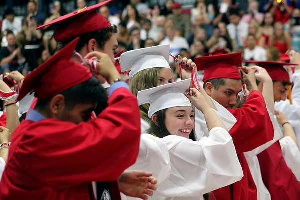 Roger Schneider | The Goshen News<br /> Abigail Biggs smiles with joy as she and her Goshen High School classmates turn their tassles after receiving their diplomas Sunday.
