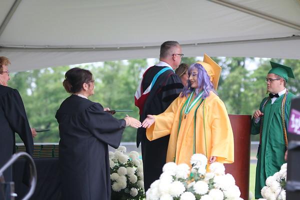 AIMEE AMBROSE   THE GOSHEN NEWS <br /> Dayanna Gomez Gonzalez receives her diploma during Northridge High School's graduation ceremony in Middlebury Sunday.