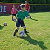BEN MIKESELL | THE GOSHEN NEWS<br /> Peter Fussner, 7, of Goshen, leads the group in dribbling drills during soccer camp Tuesday morning at Shanklin Park.