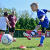 BEN MIKESELL | THE GOSHEN NEWS<br /> Charlie Granzow, 7, of Goshen, aims for the net during a drill Tuesday morning at Shanklin Park.