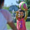 BEN MIKESELL | THE GOSHEN NEWS<br /> Greenlee Munoz, 7, of Goshen, winds up for a throw-in during a drill Tuesday morning at Shanklin Park.