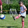 BEN MIKESELL | THE GOSHEN NEWS<br /> Aubrey Morales, 6, of Goshen, strikes the ball during a passing drill at soccer camp Tuesday morning at Shanklin Park.