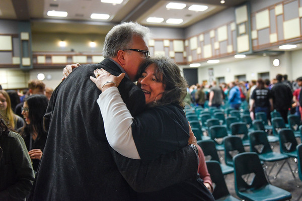 BEN MIKESELL | THE GOSHEN NEWS<br /> Cheryl Stouder, teacher at Concord Junior High School, embraces Joe Varga, South Bend, at the end of the opening ceremony for Concord's Make-A-Wish fundraiser Thursdsay morning at the Junior High School. Varga spoke to the students about his daughter, Mary Cate, who was a Make-A-Wish recipient in 2017. Concord Junior High School staff have raised funds for the Make-A-Wish Foundation since 1995, and have raised more than $385,000 in that time. This year's fundraiser, helping three local children fulfill their dreams, will conclude March 29.