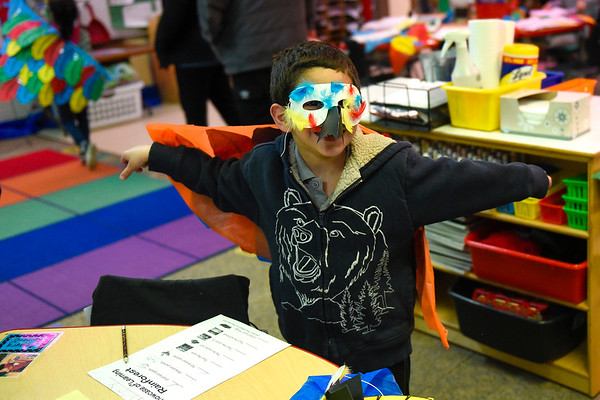 BEN MIKESELL | THE GOSHEN NEWS<br /> Kindergartner Amaury Romero shows off his macaw mask and wings during the kindergarten showcase Thursday evening at Chamberlain Elementary School.