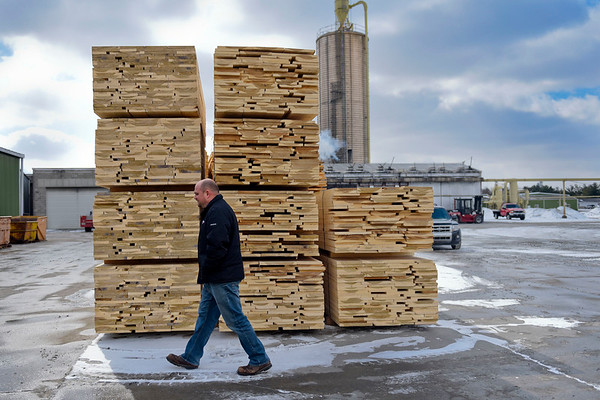 BEN MIKESELL | THE GOSHEN NEWS<br /> Andrew Carunchia walks through the grounds Thursday afternoon at Wible Lumber Co. in South Milford.