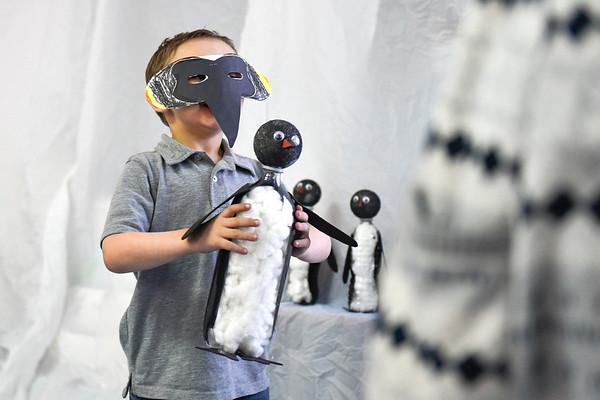 BEN MIKESELL | THE GOSHEN NEWS<br /> Kindergartner Kyle Stahl shows off his emperor penguin creation during the kindergarten showcase Thursday evening at Chamberlain Elementary School.