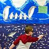 BEN MIKESELL | THE GOSHEN NEWS<br /> Kindergartner Layne Miller explains the emperor penguin's arctic habitat during the kindergarten showcase Thursday evening at Chamberlain Elementary School.