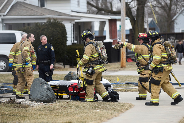 BEN MIKESELL | THE GOSHEN NEWS<br /> Goshen firefighters respond to a house fire Thursday afternoon at 425 N First St. in Goshen.