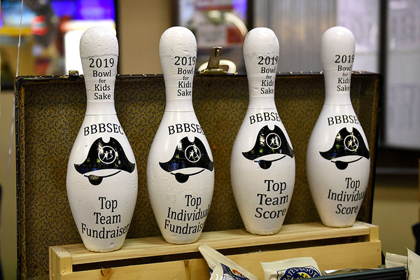 BEN MIKESELL | THE GOSHEN NEWS<br /> Pins for various awards are on display Thursday afternoon for the first day of the Bowl for Kids' Sake fundraiser at Signature Lanes in Elkhart.