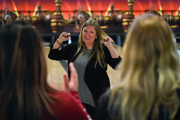 BEN MIKESELL | THE GOSHEN NEWS<br /> Rachel Stuckey, on the team representing Sanders Pianowski LLP, celebrates a spare with her teammates during the Bowl for Kids' Sake fundraiser Thursday afternoon at Signature Lanes in Elkhart.
