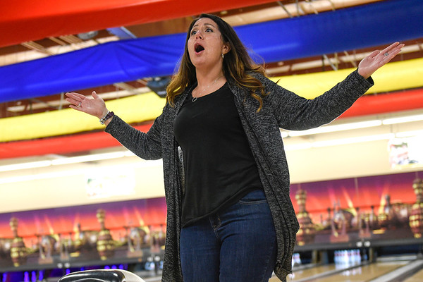 BEN MIKESELL | THE GOSHEN NEWS<br /> Rachel Stuckey, with 1st State Bank, celebrates three strikes in a row during the Bowl for Kids' Sake fundraiser Thursday afternoon at Signature Lanes in Elkhart.