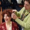 "BEN MIKESELL | THE GOSHEN NEWS<br /> Goshen High School senior Dani Horn, who plays the role of Miss Hannigan, laughs as art teacher Susan Hepler Long fixes her hair backstage before Saturday's first production of ""Annie"" at GHS. The play's last performance at GHS was Sunday."