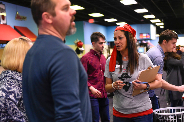 BEN MIKESELL | THE GOSHEN NEWS<br /> Crystal Denman, with Big Brothers Big Sisters of Elkhart County, talks with attendees of Thursday afternoon's Bowl for Kids' Sake fundraiser Thursday afternoon at Signature Lanes.