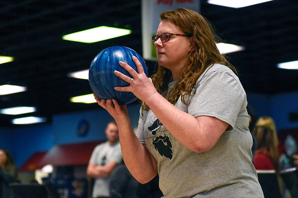 BEN MIKESELL | THE GOSHEN NEWS<br /> Shelley Murphy, with the Elkhart County Office of the Prosecuting Attorney, focuses on the pins before bowling in Thursday afternoon's Bowl for Kids' Sake fundraiser at Signature Lanes in Elkhart.