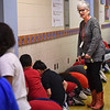 BEN MIKESELL | THE GOSHEN NEWS<br /> Fourth-grade teacher Carol Kinchen directs students during the state-wide tornado drill Tuesday morning in the cafeteria at Chamberlain Elementary School in Goshen. The students were sent to different areas within the school, including the cafeteria, and were situated within two minutes, principal Karen Blaha said.