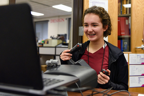 BEN MIKESELL | THE GOSHEN NEWS<br /> Goshen High School freshman Hope Kindig uses the new flight simulator in Jen Yoder's engineering class Wednesday morning at GHS.