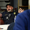 BEN MIKESELL | THE GOSHEN NEWS<br /> Goshen police officer Jeremy Welker speaks during a meeting for the warming center March 20 at The Window in Goshen.