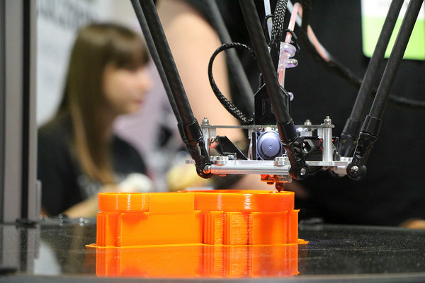 AIMEE AMBROSE | THE GOSHEN NEWS A 3D printer on display by SeeMeCNC of Ligonier is in the early stages of creating a LEGO cup during the 2019 Midwest RepRap Festival at the Elkhart County Fairgrounds Saturday.