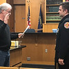 JOHN KLINE   THE GOSHEN NEWS<br /> Michael Landis, member of the Goshen Board of Public Works and Safety, left, conducts the swearing-in ceremony for Shane D. McKerchie following his promotion to the rank of EMS lieutenant with the Goshen Fire Department during the board's meeting Monday afternoon.