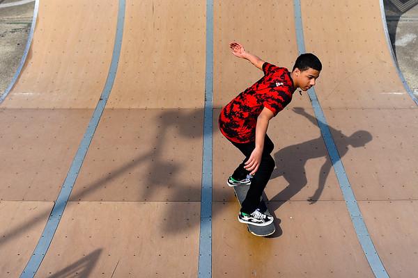 BEN MIKESELL | THE GOSHEN NEWS<br /> Rayshawn Thomas, 16, skates down the halfpipe while enjoying Goshen High School's spring break Wednesday afternoon at the Tyler S. Joldersma Skate Park.