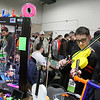 "AIMEE AMBROSE | THE GOSHEN NEWS <br /> Alex Wilkinson of ""Hackmonkey"" out Kansas City, Missouri poses with a violin made with a 3D printer during the 2019 Midwest RepRap Festival at the Elkhart County Fairgrounds Saturday."