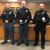 JOHN KLINE | THE GOSHEN NEWS<br /> Goshen Police Chief Jose Miller, left, poses for a photo with Ptl. John McKalips and Lt. Jeremy Welker during the Goshen Board of Public Works and Safety meeting Monday. McKalips and Welker were both awarded the department's Life-Saving award for their exemplary service during an incident Jan. 10 in Goshen.