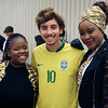 JOHN KLINE | THE GOSHEN NEWS<br /> Goshen College International Student Club members, from left, Sonia Nzuzi, of the Democratic Republic of Congo, Lucas Vilela, of Brazil, and Deborah Kankolongo, also of the Democratic Republic of Congo, pose for a quick photo prior to the kickoff of the annual ISC Coffeehouse event at the college Saturday evening.
