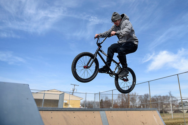 BEN MIKESELL | THE GOSHEN NEWS<br /> Erik Bedell, of Goshen, does a 180 off a spine ramp while enjoying the warm weather Wednesday afternoon at the Tyler S. Joldersma Skate Park in Goshen.