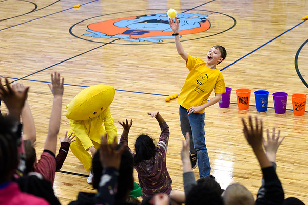 BEN MIKESELL | THE GOSHEN NEWS<br /> Jack Gorski, 10,  tosses goodies into the crowd of children gathered for the Lemonade Day kick-off rally Monday afternoon at the Boys and Girls Club in Elkhart. Gorski was a participant in last year's Lemonade Day, and was named the Youth Entrepreneur of the Year in Elkhart County. This year's Lemonade Day begins May 18. The event is sponsored by Junior Achievement and teaches youth business skills.