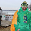 AIMEE AMBROSE | THE GOSHEN NEWS <br /> Joseph DeMoss, Mishawaka, dressed up as an Irish superhero during the 14th annual Leprechaun Leap outside Re-Pete's Simonton Lake Tavern, 51426 Ind. 19, Saturday. While DeMoss didn't jump, several other people plunged into the icy lake as part of a fundraiser to benefit Cancer Resources for Elkhart County.