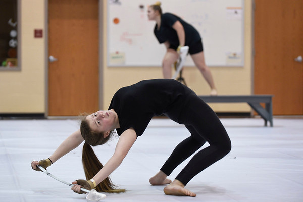 BEN MIKESELL | THE GOSHEN NEWS<br /> Goshen High School freshman Anna VanderWey practices her routine Thursday evening at Prairie View Elementary School, before the winter guard heads to state this weekend in Indianapolis.