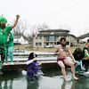 AIMEE AMBROSE | THE GOSHEN NEWS A team of regulars and patrons from My Dad's Place bar jump into the icy Simonton Lake during the 14th annual Leprechaun Leap outside Re-Pete's tavern, 51426 Ind. 19, Saturday. The crew from My Dad's Place, across the street from Re-Pete's, was among a host of others who plunged into the lake as part of a fundraiser to benefit Cancer Resources for Elkhart County.