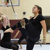 BEN MIKESELL | THE GOSHEN NEWS<br /> Goshen High School Junior Karen Esquivel practices her routine Thursday evening at Prairie View Elementary School, before the winter guard heads to state this weekend in Indianapolis.