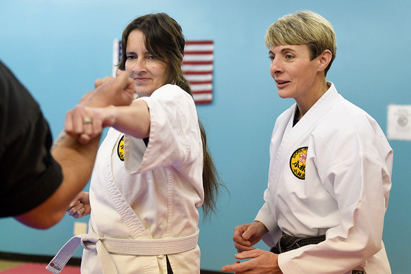 BEN MIKESELL | THE GOSHEN NEWS<br /> Instructor Darlene Guthrie, right, watches on as Diana Miller, Elkhart, practices punches during class Tuesday evening at the Elkhart Okinawa Karate Club.